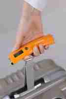 Luggage Checker - Hand Held Portable Scales in Orange